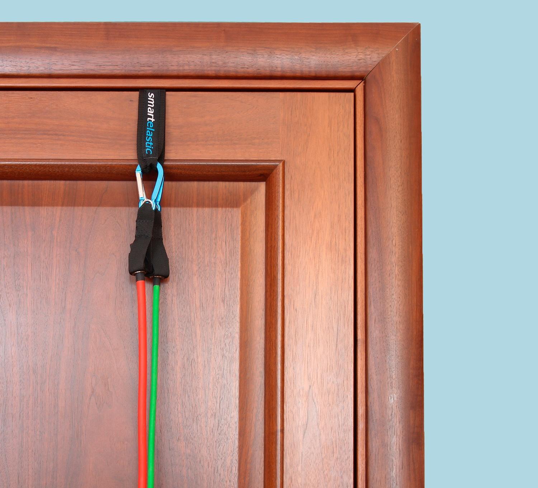 Дверной фиксатор для крепления эластичных трубок посередине